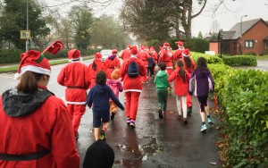 Santa Dash for Myton Hospices 2015 | Running along the Myton Road in Warwick